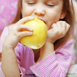 Stock Photo: Child eating an apple