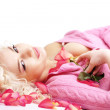 Woman lying on petals — Stock Photo