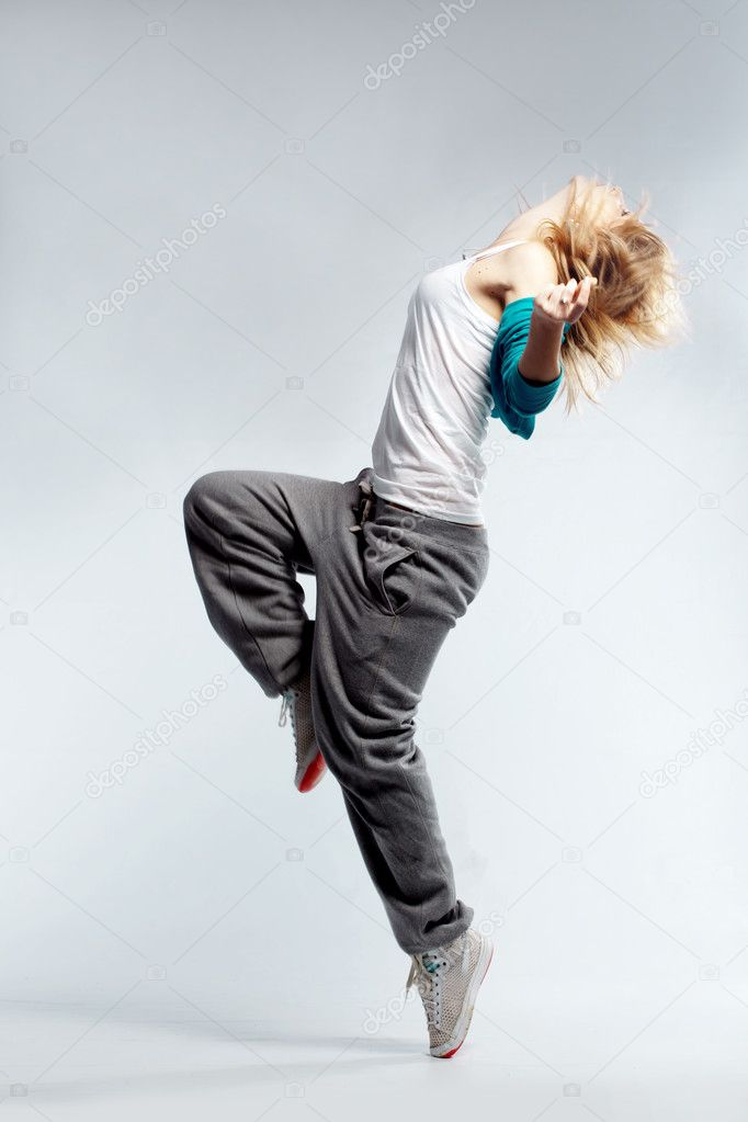 Фото со стока - Девушка танцевать хип-хоп в студии.