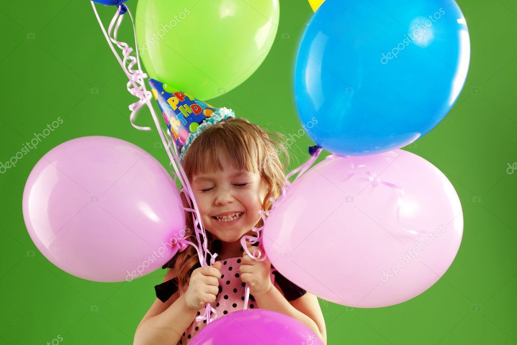 Child celebrating birthday on green studio background  Stock Photo #2791021