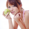 Cute teenage girl with apples — Stock Photo #3056776