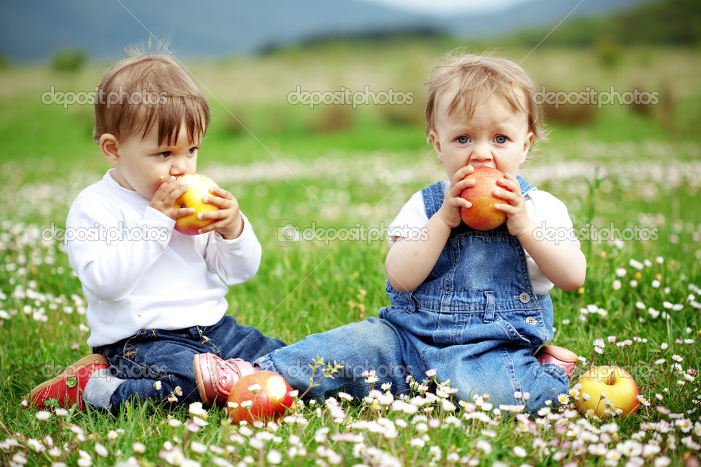 Cute happy children playing in spring filed  Stock Photo #3091032