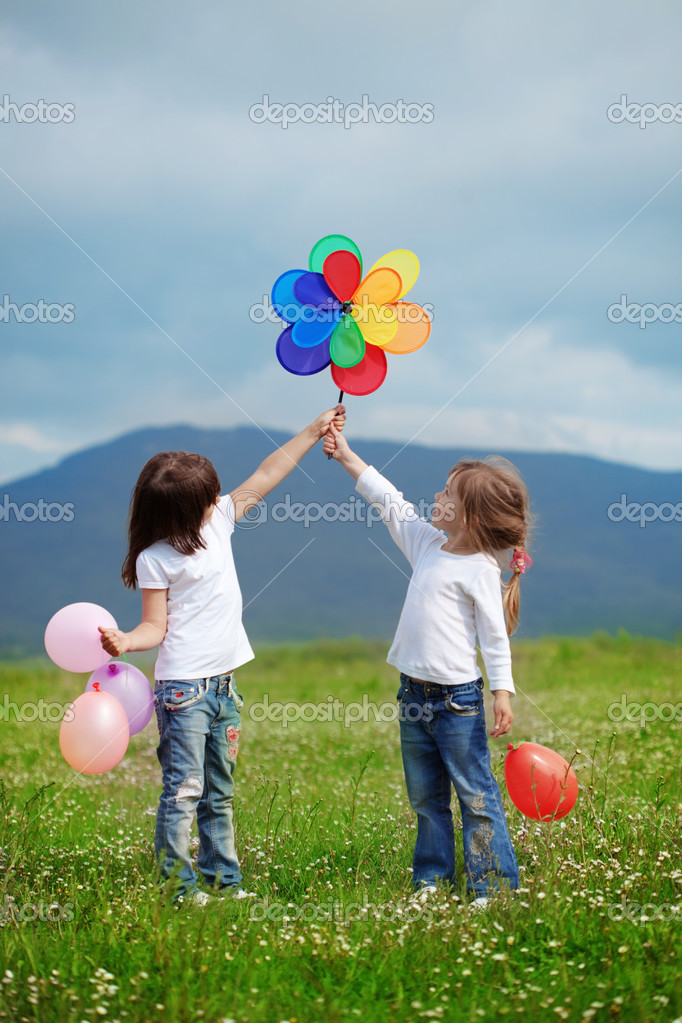 Cute happy children playing in spring filed — Stock Photo #3091038