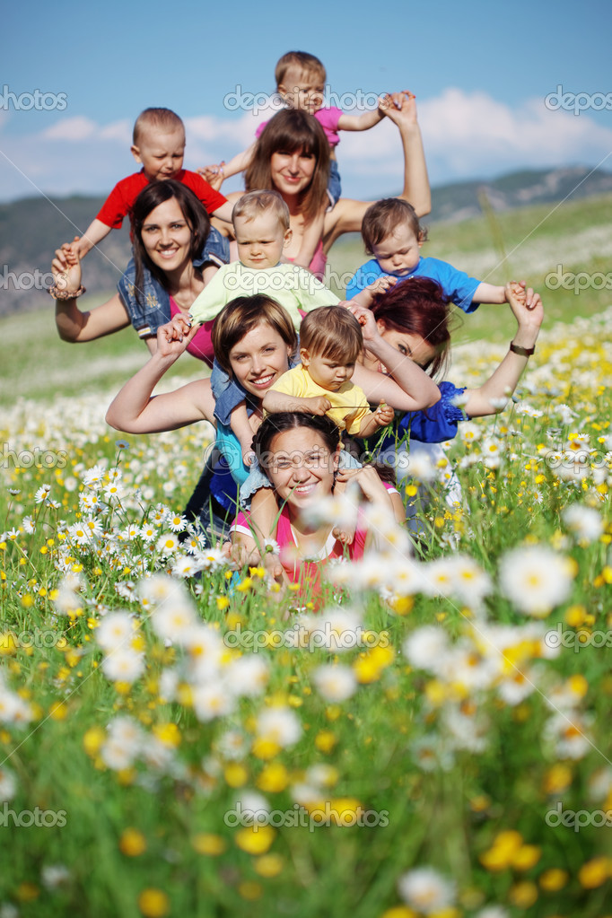 Mothers with children in flower field — Stock Photo #3131663