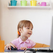 Kid girl with laptop — Stock Photo