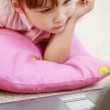 Kid girl with laptop - Stock Photo