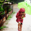 Little girl walking in the rain — Stock Photo #3480591