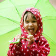 Little girl walking in the rain — Stock Photo #3480646