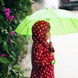 Little girl walking in the rain — Stock fotografie