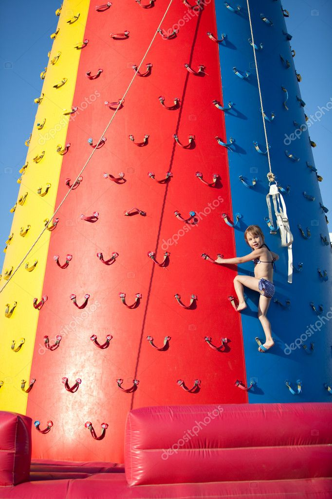 Child climbing on air wall — Stock Photo #3523813