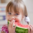 Funny child eating watermelon — Stock Photo #3568485