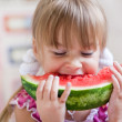 Funny child eating watermelon — Stock Photo #3568492