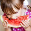 Funny child eating watermelon — Stock Photo #3568503