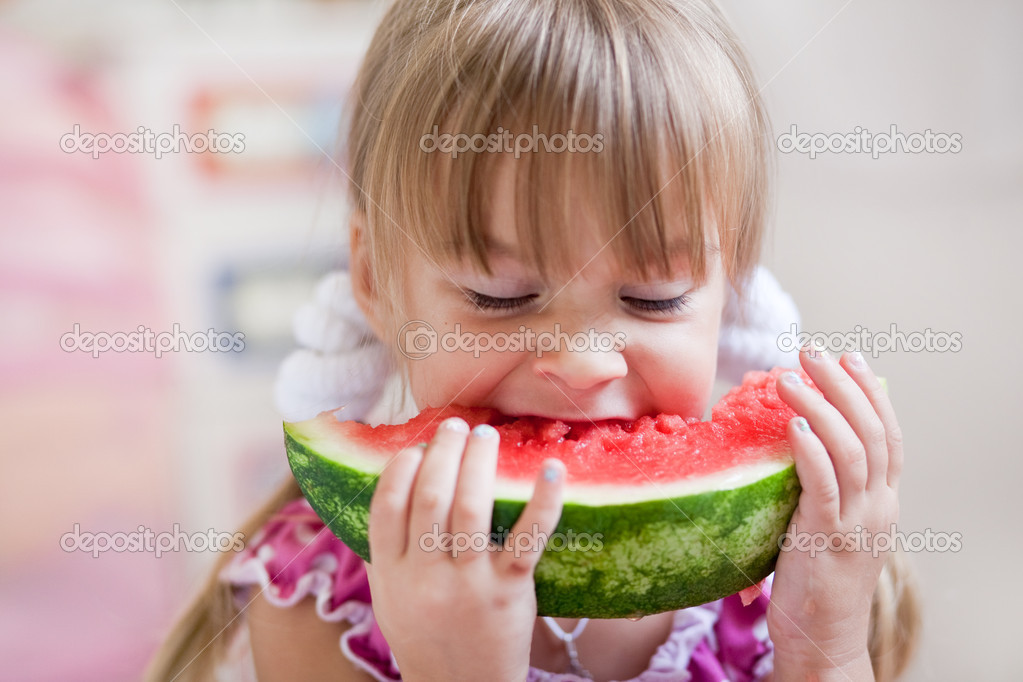 Fauuny child eating watermelon closeup  Stock Photo #3568492