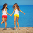 Girls running at beach — Stock Photo #3583347