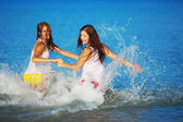 Girls in water — Stock Photo