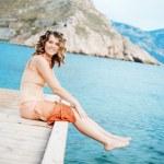 Girl posing on berth — Stock Photo #3601505