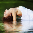 Beautiful girl in river - Stock Photo