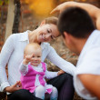 Parents with baby in autumn — Stock Photo #3623355