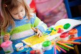 Little girl painting — Stock Photo