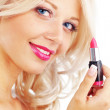 Applying lipstick — Stockfoto