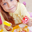 Cute child eating candies — Stock Photo #3754545