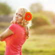 Cute girl with flower — Stock Photo #3861171
