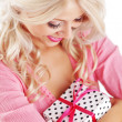 Young woman holding gift — Stock Photo #3902103