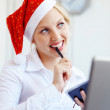 Santa helper working in office — Photo
