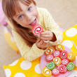 Cute child eating candies - Stock Photo