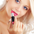 Applying lipstick — Stockfoto #3902309