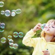 Child starting soap bubbles — Stock Photo