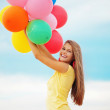 Girl with balloons — Stock Photo #3917202