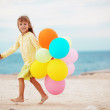 Little girl with balloons — Stock Photo #3921283