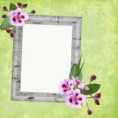 Framework for photo or congratulation with bunch of flowers. — Stock Photo