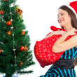 Stock Photo: Girl near Christmas fir tree