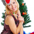 Girl near Christmas fir tree — Stock Photo #4020796
