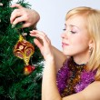 Girl near Christmas fir tree - Foto Stock