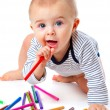 Baby with pencils - Stock Photo