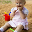 Royalty-Free Stock Photo: Little girl in sandbox
