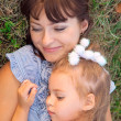 Mother and daughter lay on the grass — Stock Photo
