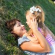 Stock Photo: Mother and daughter lay on grass