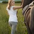 Young blond woman with horse — Foto de Stock