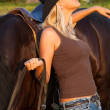 Young blond woman with horse — Stock Photo #4022161