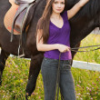 The young blond woman with a horse — Stock Photo