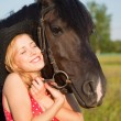 Young blond woman with horse — Stock Photo #4022229