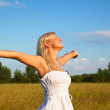 Young blond girl enjoying the freedom — Stock Photo #4022278