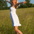 Young blond girl enjoying the freedom — Stock Photo