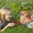Two young blond women eating strawberries — Stock Photo #4022311