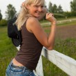 Young cowgirl stand near a fence — Stock Photo #4022378